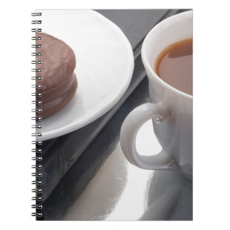 White cup with cocoa and chocolate covered biscuit spiral notebook