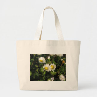 White daisy flowers on green background large tote bag