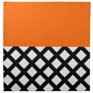white diamonds in black and orange cloth napkin