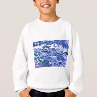 White Dogwood Blossom in Blue Sweatshirt