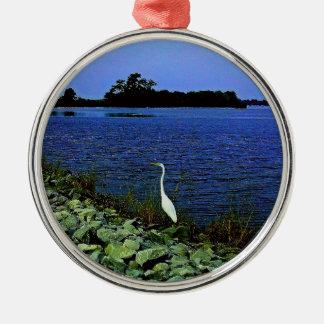 White Egret On Rocky Shore Line Silver-Colored Round Decoration