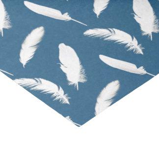 White feather print on denim blue tissue paper