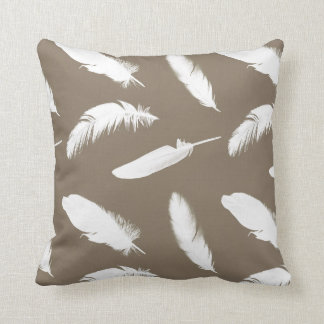 White feather print on taupe cushion