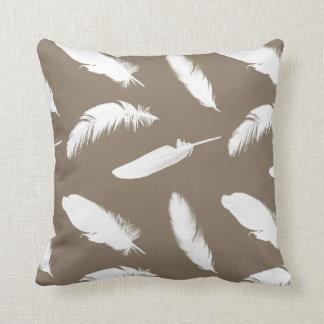 White feather print on taupe throw pillow