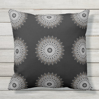 White filigree medallion with gold trim outdoor cushion