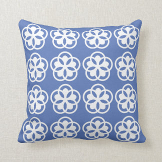 white floral pattern on light blue cushion