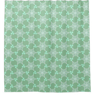 White floral stars and spots on pastel green shower curtain