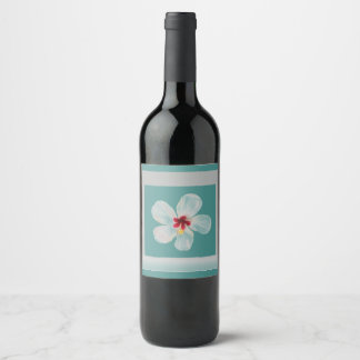 white flower framed in gray and teal wine label
