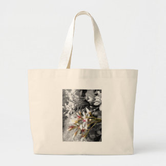 White flower on black and white background tote bags