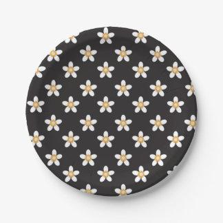 white flower on black paper plate