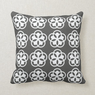 white flower pattern on gray throw pillow