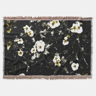 white flowers black throw blanket