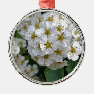 White flowers glowing metal ornament