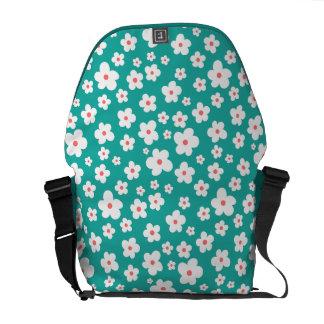 White flowers on custom color messenger bags