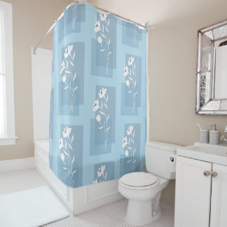 white flowers on the blue shower curtain