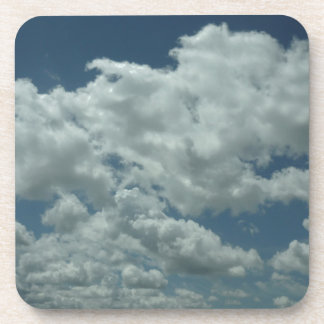 White fluffy clouds in blue sky drink coasters