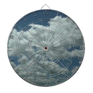 White fluffy clouds in blue sky dartboard