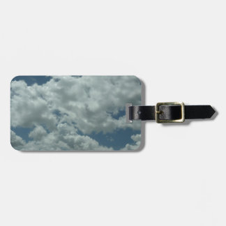 White fluffy clouds in blue sky luggage tags
