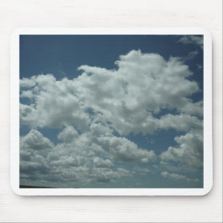 White fluffy clouds in blue sky mousepad