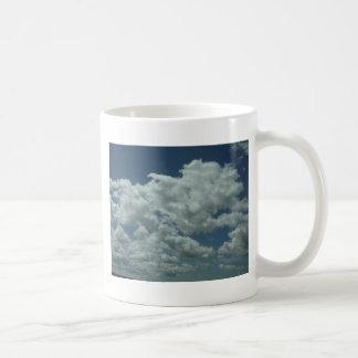 White fluffy clouds in blue sky mugs