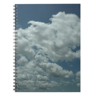 White fluffy clouds in blue sky notebook