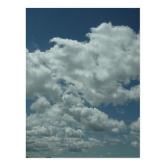 White, fluffy clouds in blue sky postcard
