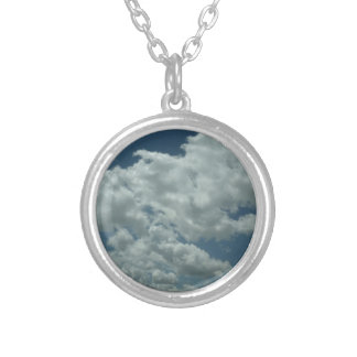 White, fluffy clouds in blue sky round pendant necklace