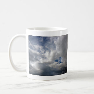 White fluffy clouds on the blue sky mugs