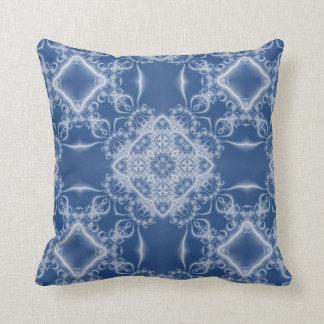 White fractal lace on blue cushion