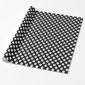 White Golf Balls on Black Wrapping Paper