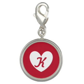 White heart on red with monogram