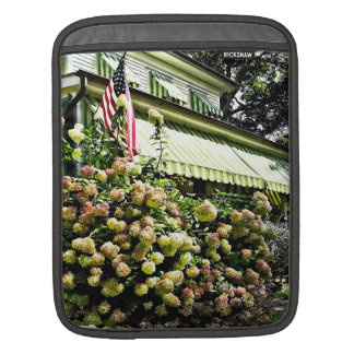 White Hydrangeas By Green Striped Awning iPad Sleeve