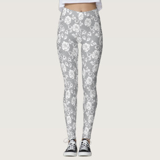 White lace pattern on gray background leggings