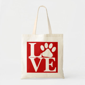White LOVE Word Dog Paws Pattern On Red Background Tote Bag