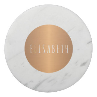 White marble stone with copper circle your name eraser