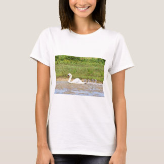 White mother swan swimming in line with cygnets T-Shirt