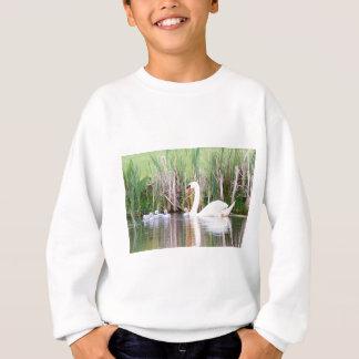 White mother swan swimming with chicks sweatshirt