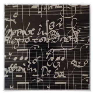 white music notation on black background photograph