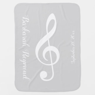 white musical note / treble clef on pale gray baby blanket