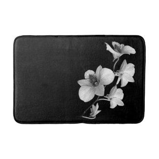 White Orchid on Black Bath Mat