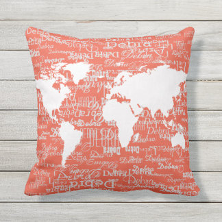 white pattern of names & world map, on coral outdoor cushion