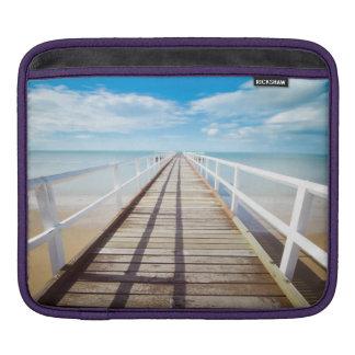 White pier on the ocean coast iPad sleeve