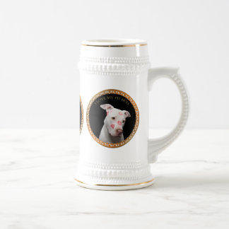 White pitbull with red kisses all over his face. beer stein