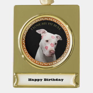 White pitbull with red kisses all over his face. gold plated banner ornament