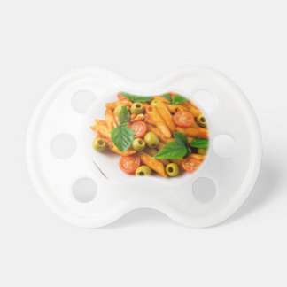 White plate of penne pasta decorated with cherry dummy