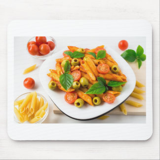 White plate of penne pasta decorated with cherry mouse pad
