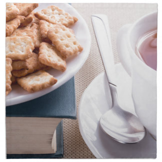 White plate with cookies on old book napkin