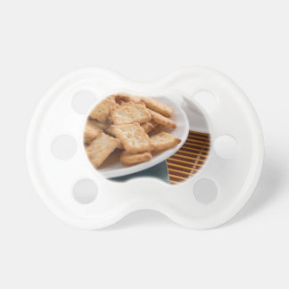 White plate with cookies on the old book dummy