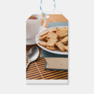 White plate with cookies on the old book gift tags