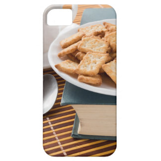 White plate with cookies on the old book iPhone 5 case